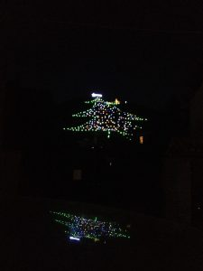 The city of Gubbio, Italy, lit up on its mountain like a giant Christmas tree